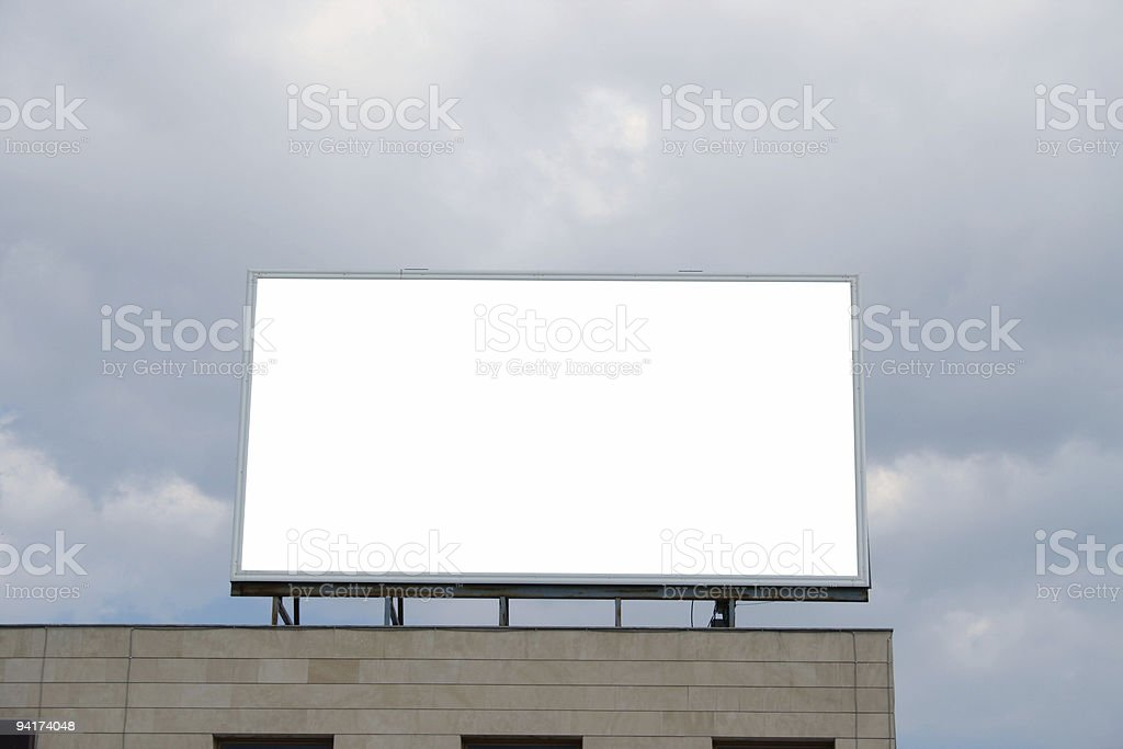 Billboard on top of a building royalty-free stock photo
