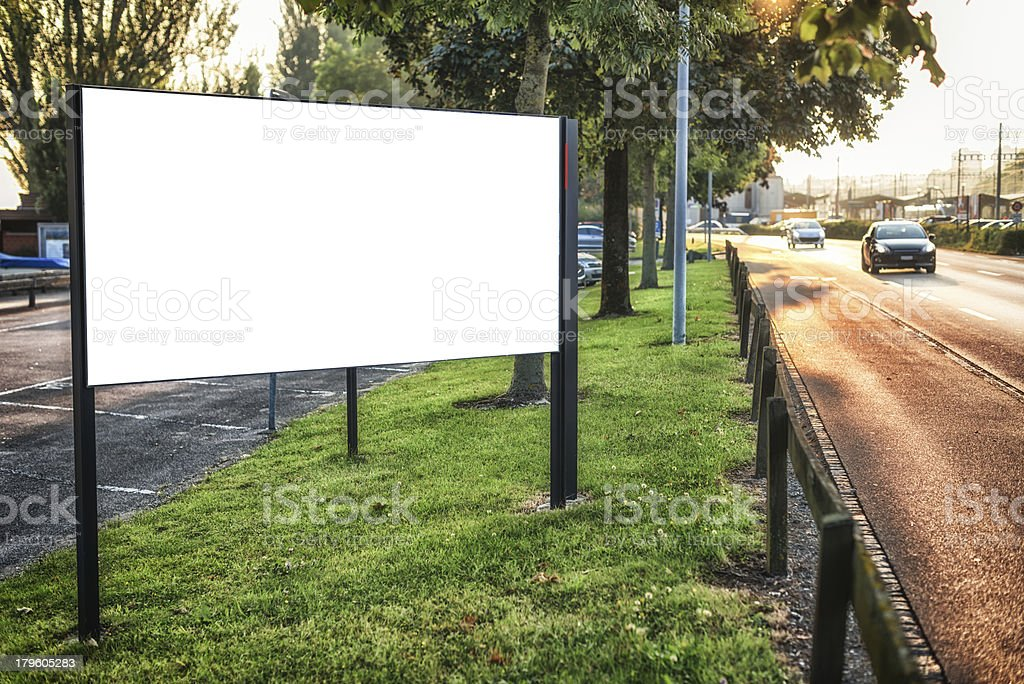 billboard sign at roadside early in the morning. clipping path...