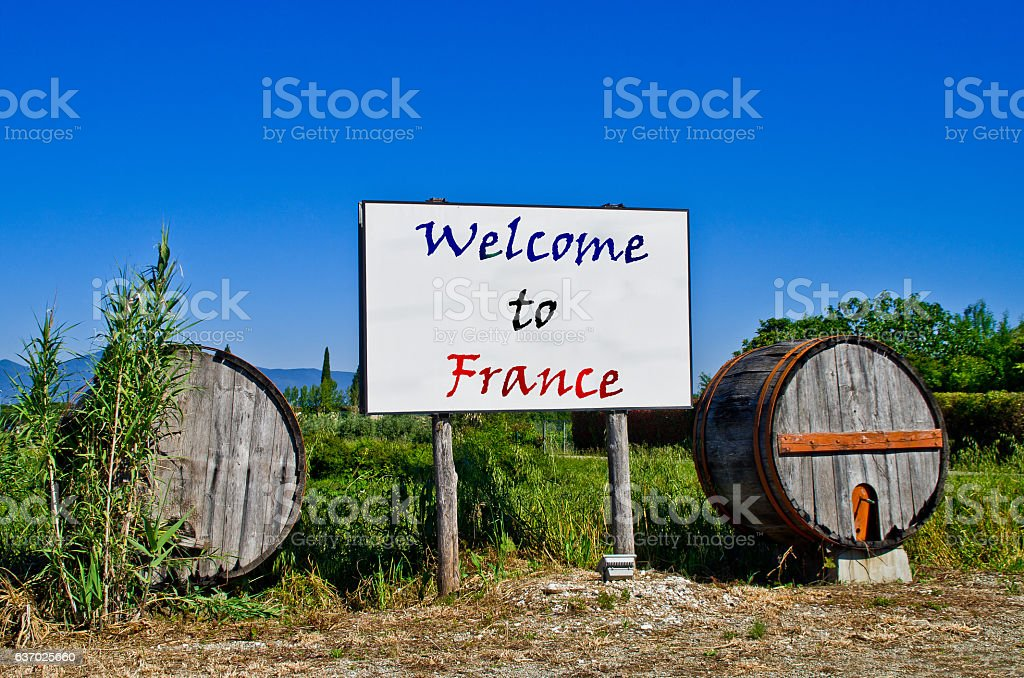 Billboard with barrels says Welcome in France stock photo