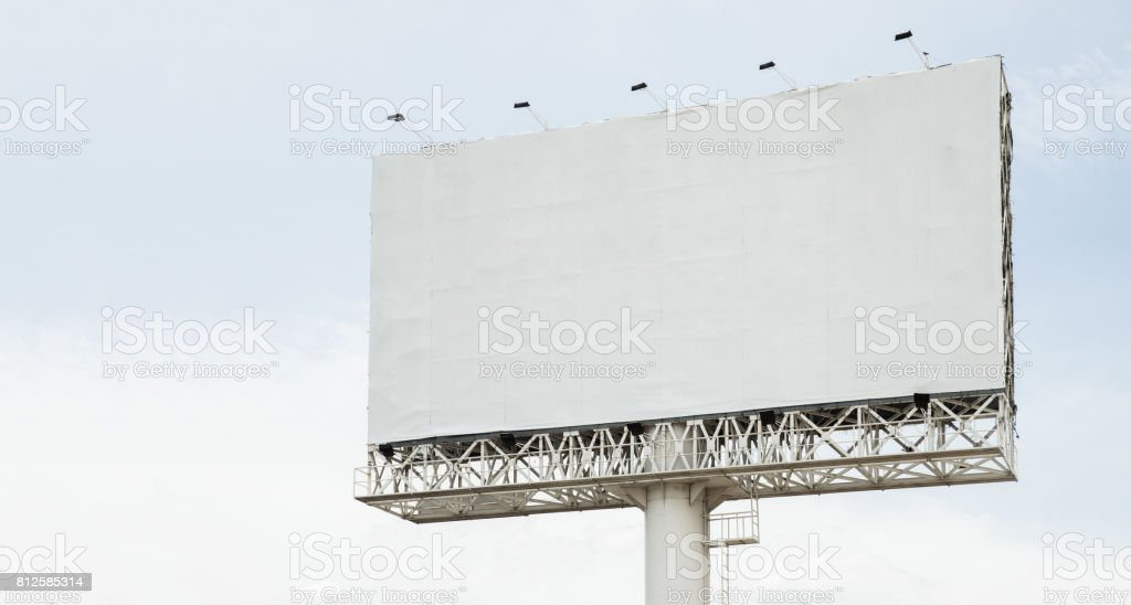 Billboard with blank screen, against blue cloudy sky. Useful for your advertisement stock photo