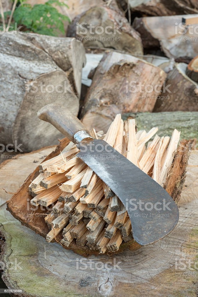 Billhook Knife on a Pile of Firewood stock photo