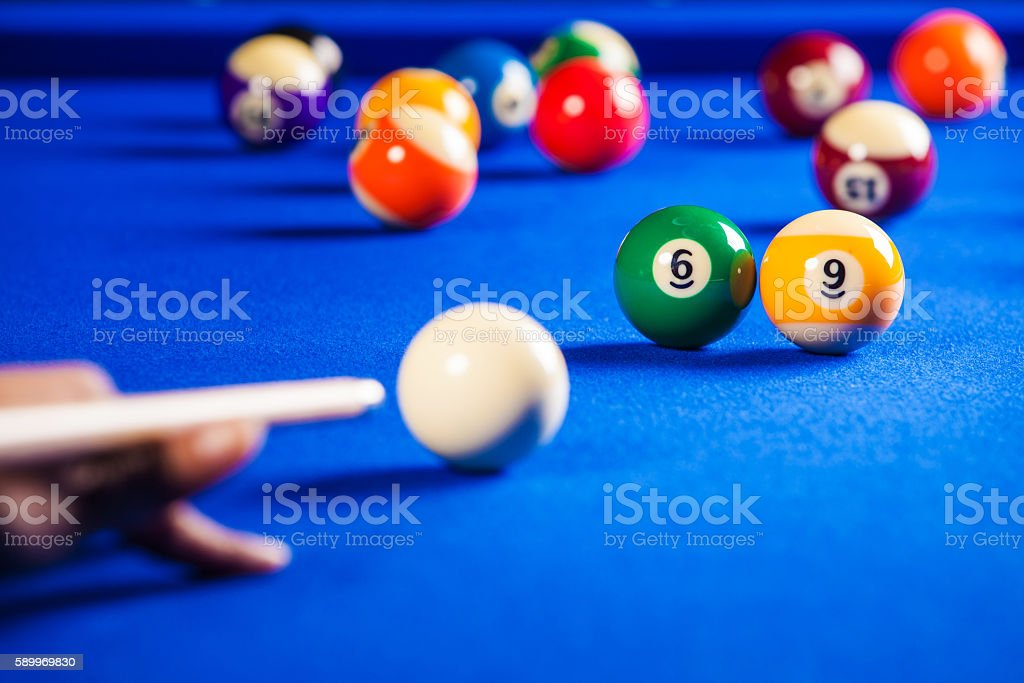 billiard balls in a blue pool table stock photo