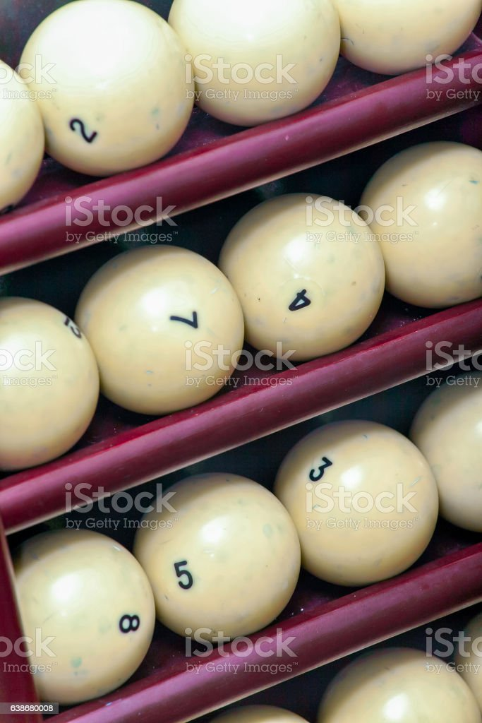 Billiard balls made of ivory on a wooden stock stock photo