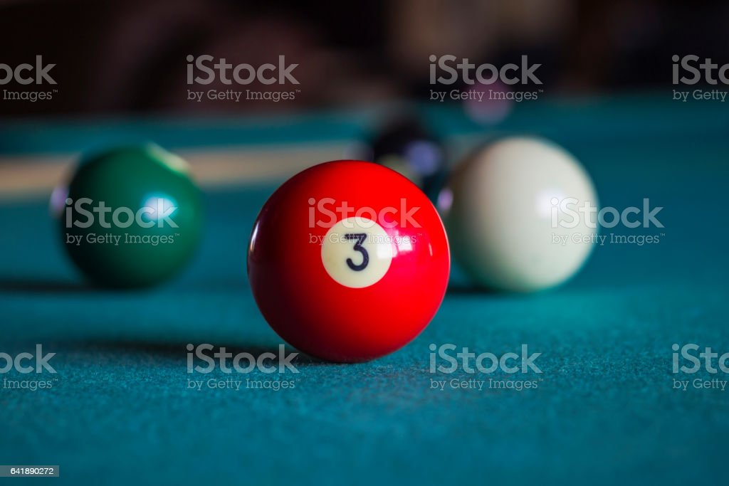 Billiard balls on a pool table, Three ball. stock photo