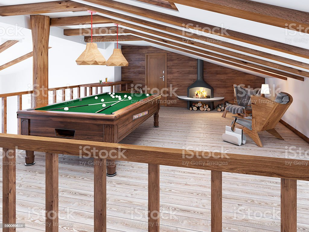 Billiard room in the attic with sitting area and fireplace. stock photo