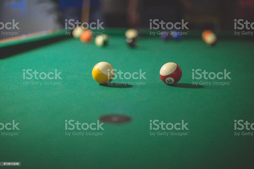 Billiard table with balls on it stock photo
