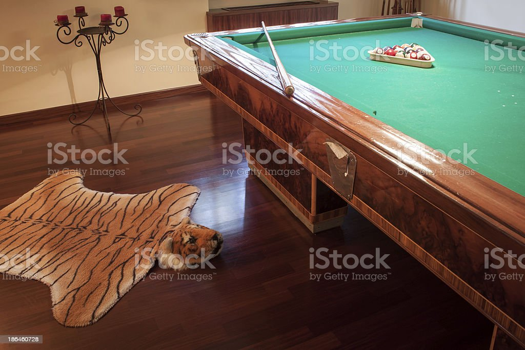 Billiard table with mock tiger skin rug royalty-free stock photo