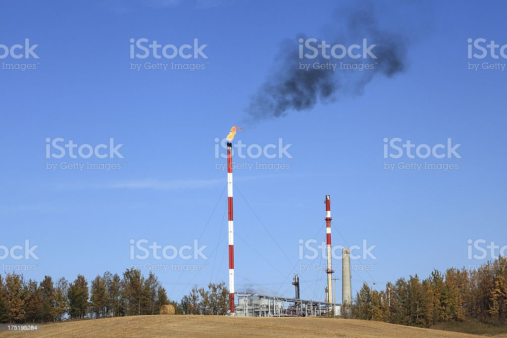 Billowing Black Smoke And Refinery Landscape royalty-free stock photo