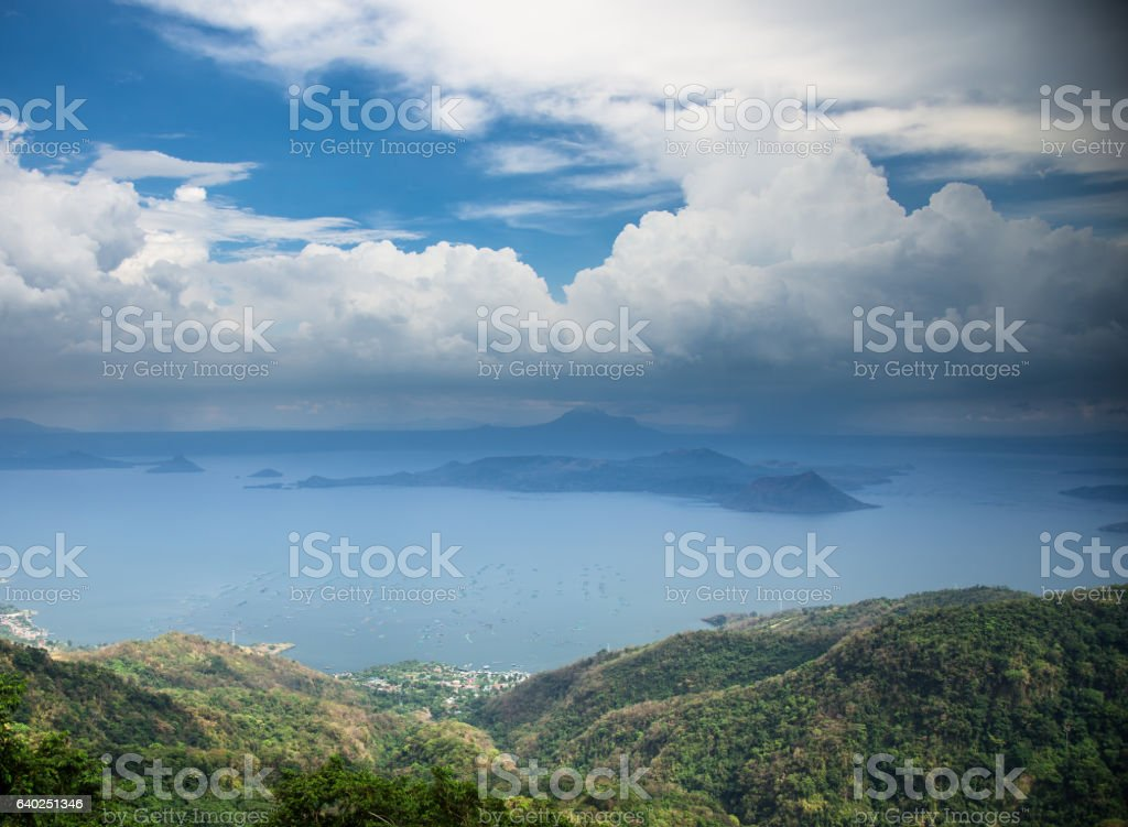 Billowing Clouds Over Taal Lake and Volcano Island stock photo