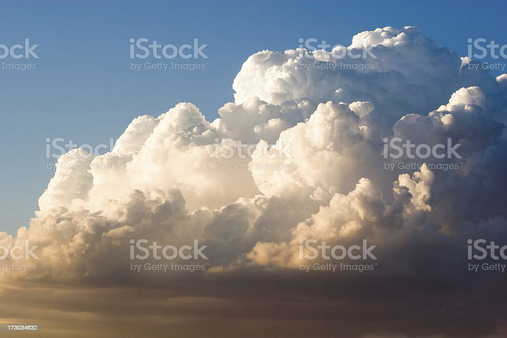 Billowing White Cumulus Nimbus Clouds in Sky stock photo