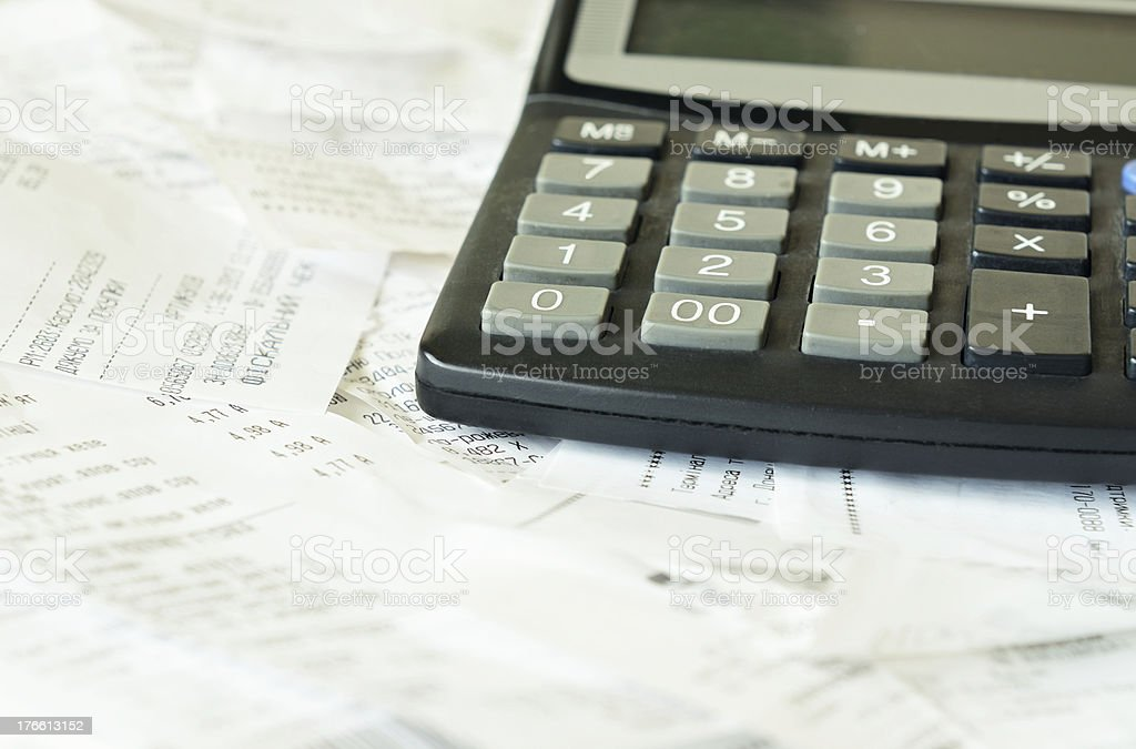 Bills and calculator royalty-free stock photo