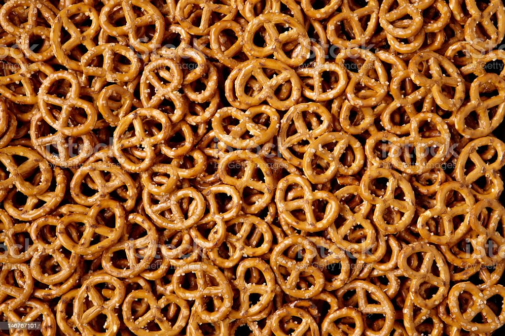 Bin filled with small, salty pretzels stock photo