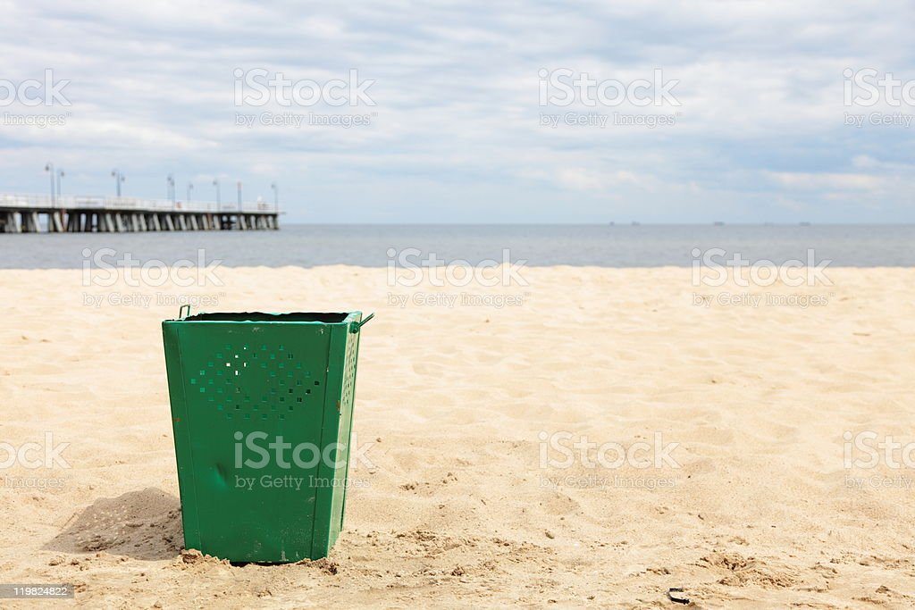 bin garbage at beach stock photo