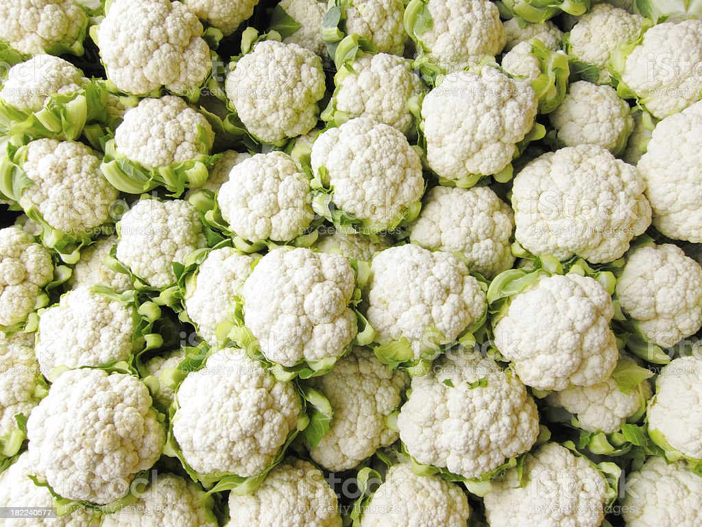 Bin of Cauliflower Heads stock photo