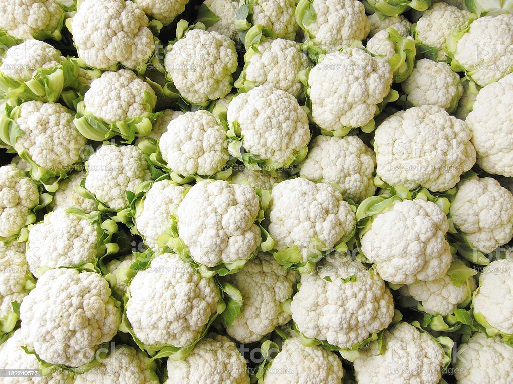 Bin of Cauliflower Heads stock photo