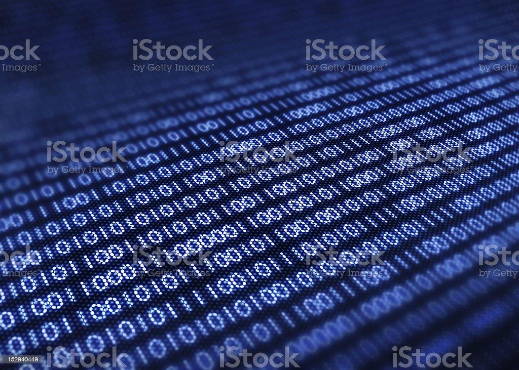 Binary code on pixellated screen stock photo