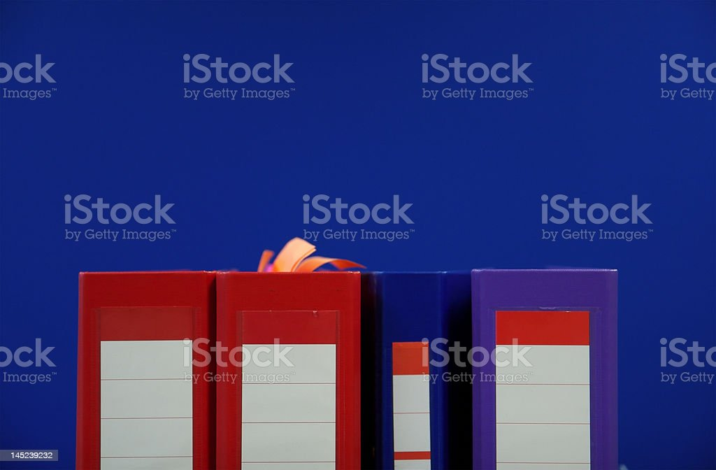 Binders on blue background royalty-free stock photo