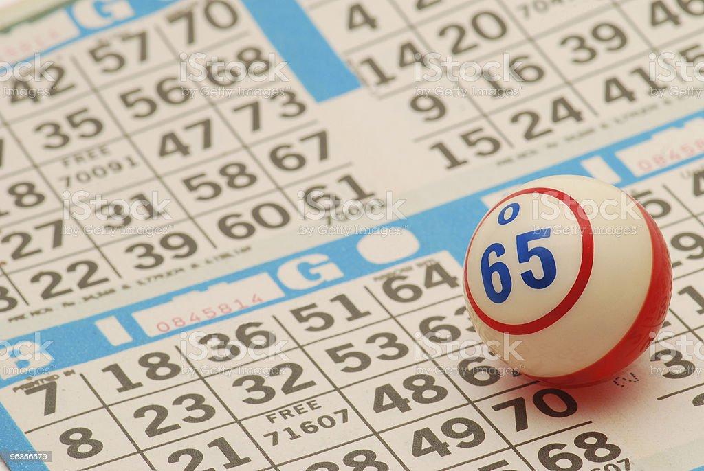 Bingo ball on a new bingo card stock photo