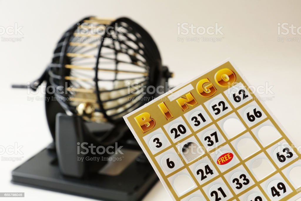 bingo cage, balls with numbers, card and markers. stock photo