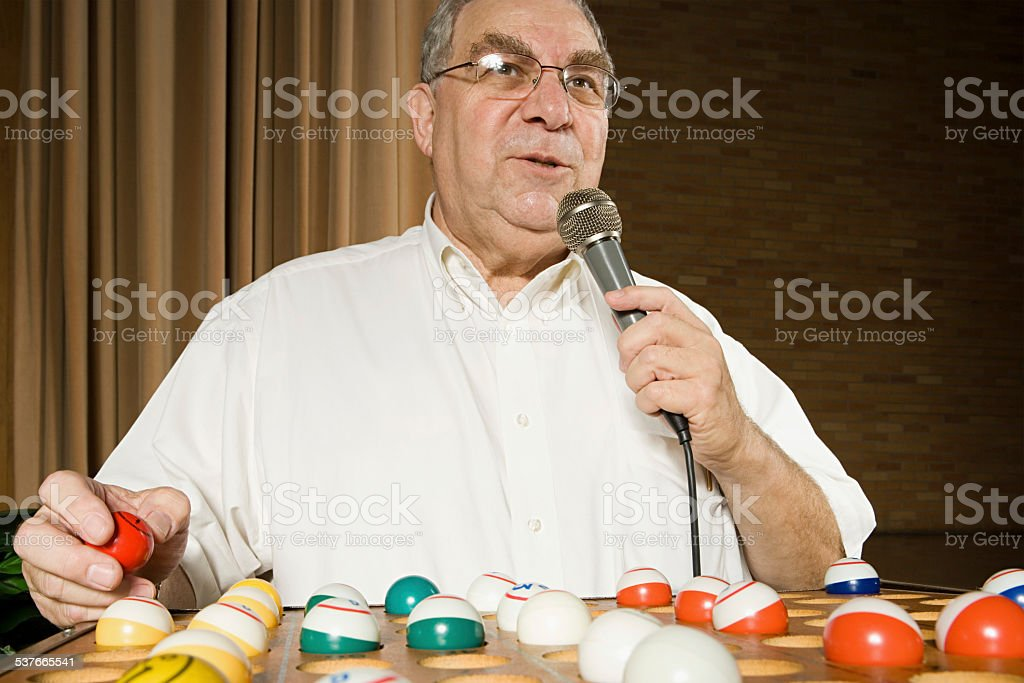 Bingo caller at work stock photo