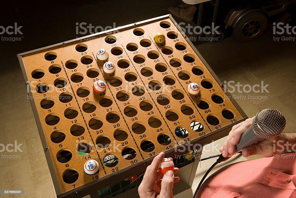 Bingo caller at work stock photo