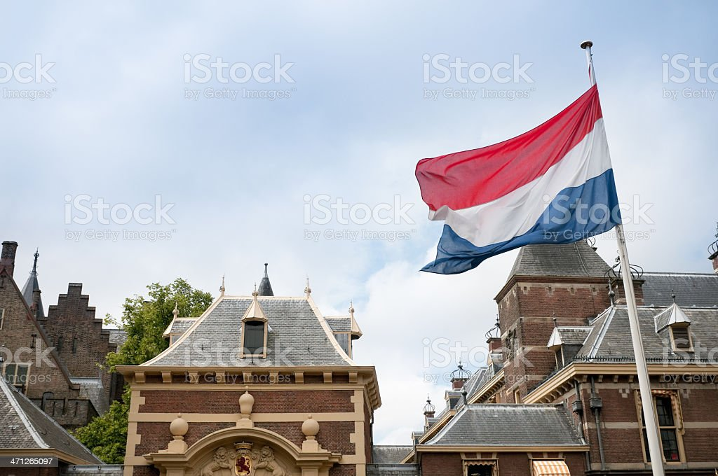 Binnenhof with Dutch Flag, parliament building, The Hague royalty-free stock photo