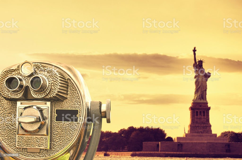 Binocular against the statue of liberty royalty-free stock photo