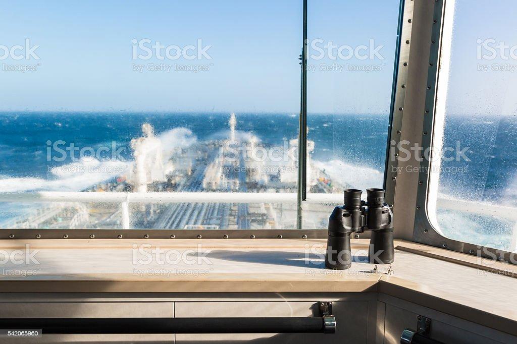 Binocular on the windowsill of navigation bridge. stock photo