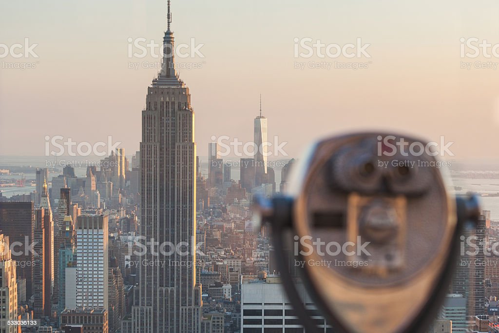 Binocular with New York Skyscrapers on Background at Sunset stock photo