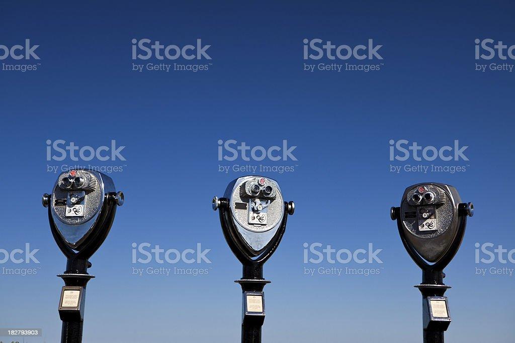 Binoculars against the sky stock photo