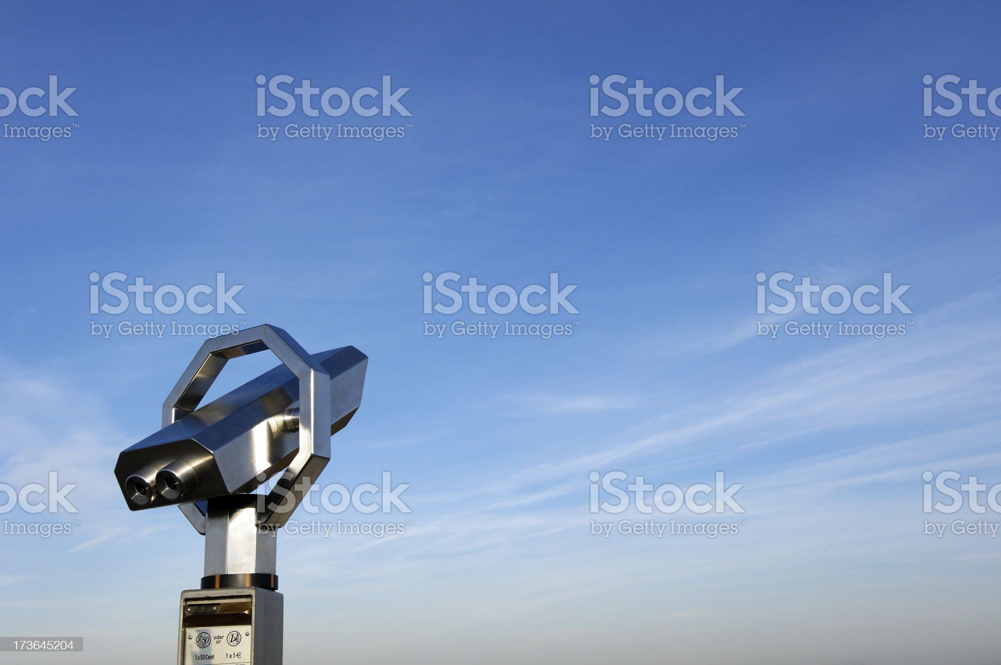 Binoculars and blue sky royalty-free stock photo