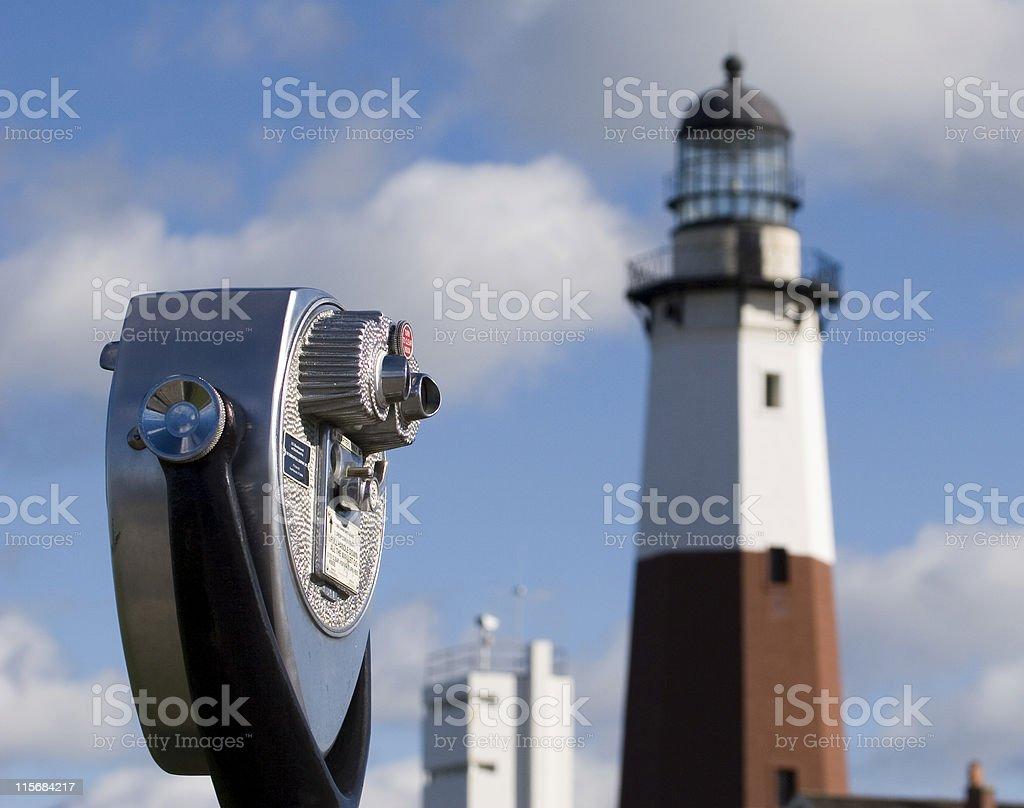 Binoculars and lighthouse stock photo
