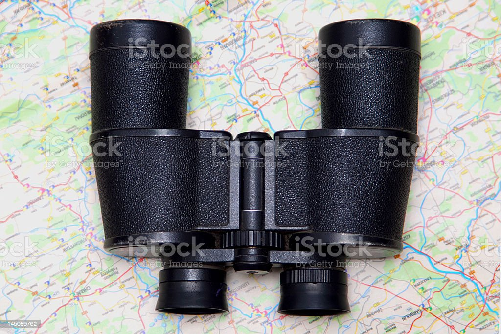 Binoculars and map royalty-free stock photo