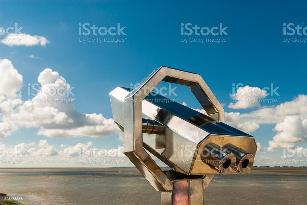 binoculars at north sea region stock photo