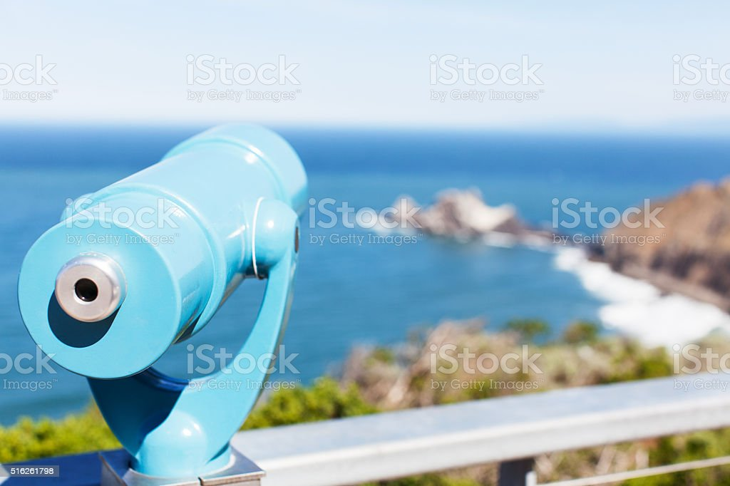 binoculars at the beach stock photo