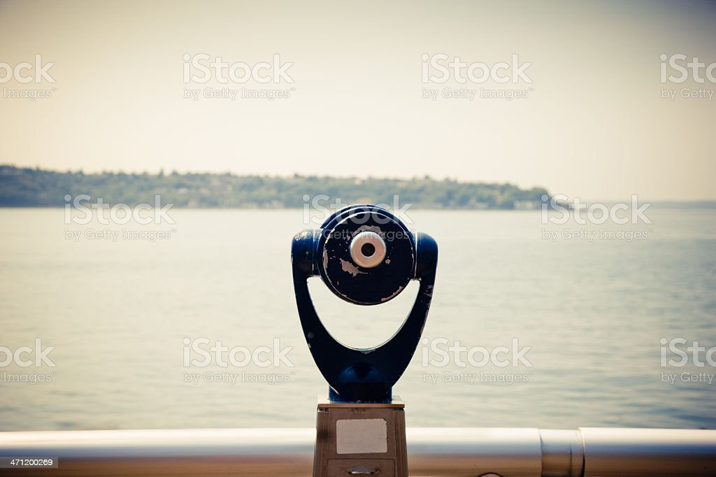 Binoculars by the water stock photo