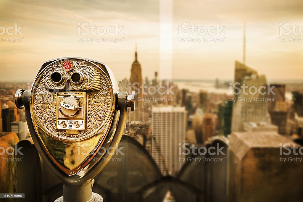 Binoculars Overlooking New York City Skyline At Empire State Building stock photo