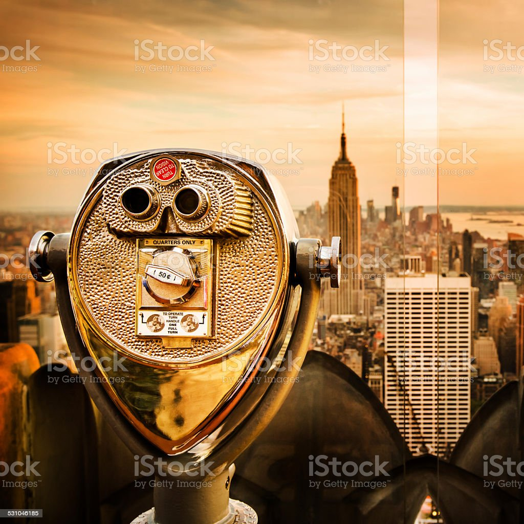 Binoculars Overlooking New York City Skyline At Empire State Building stock photo