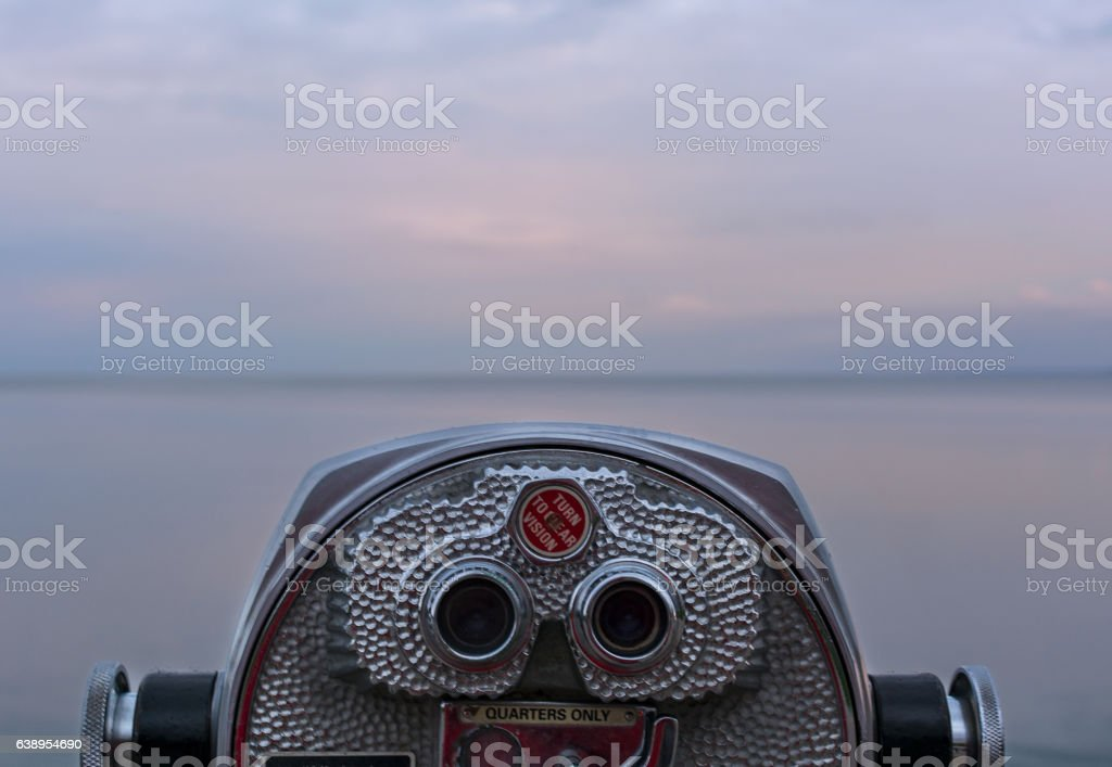 binoculars overlooking water stock photo