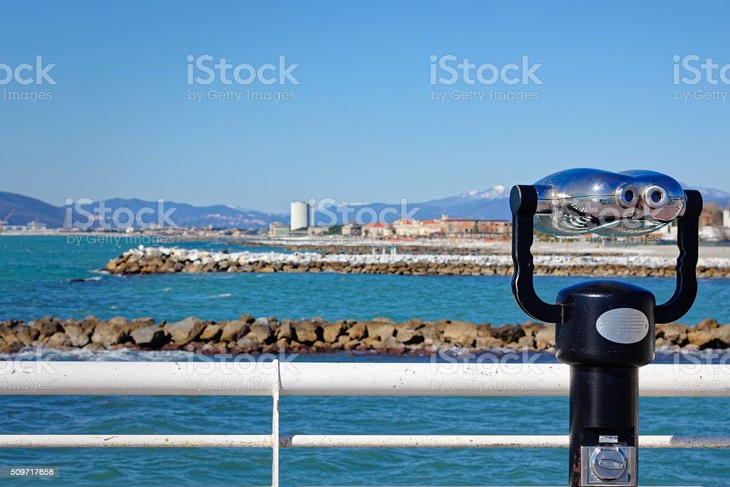 Binoculars paid view from the coast of Massa jetty stock photo