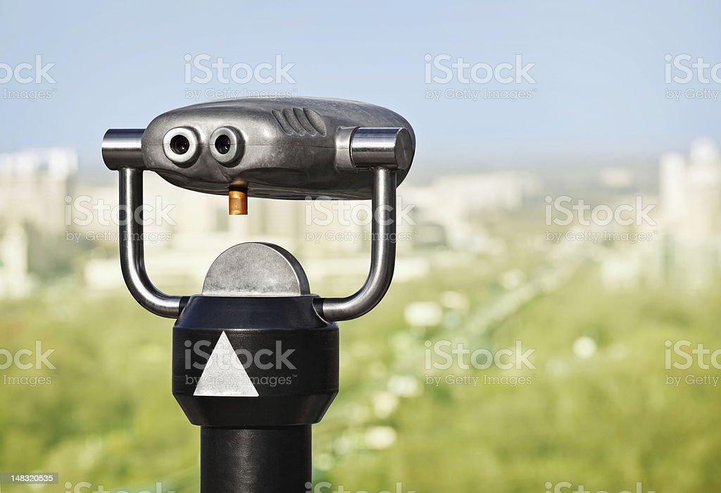 Binoculars to observe green city stock photo