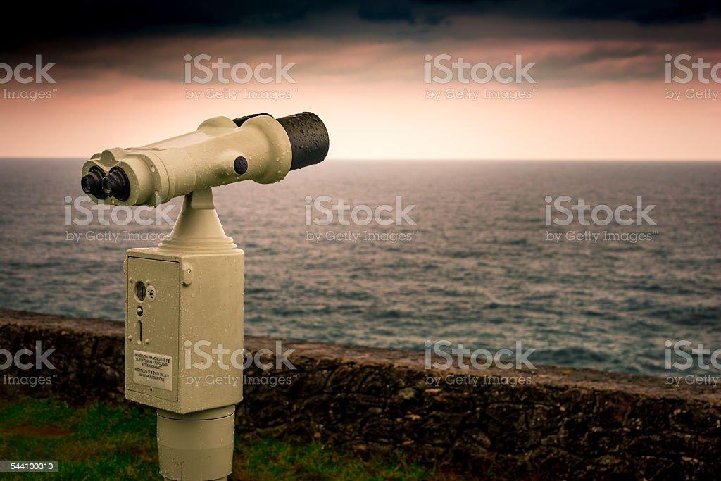 Binoculars, watching the skyline I stock photo