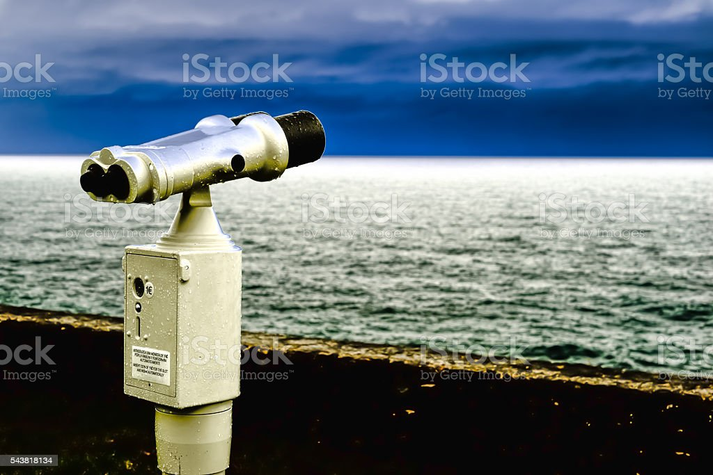 Binoculars, watching the skyline stock photo