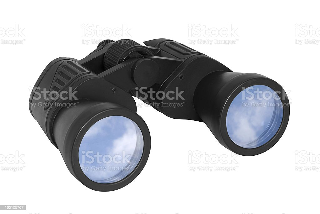Binoculars with blue sky reflected on lenses royalty-free stock photo