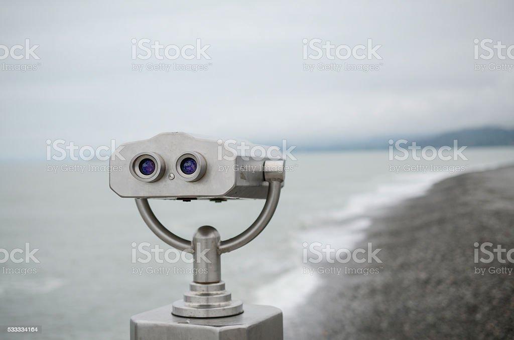 Binoculars with wonderful view, gray binoculars for viewing, sea stock photo