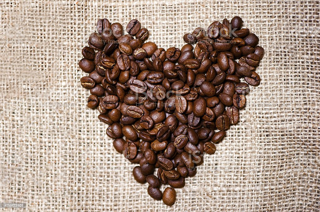 Bio fresh roasted coffee beans isolated on vintage cloth stock photo