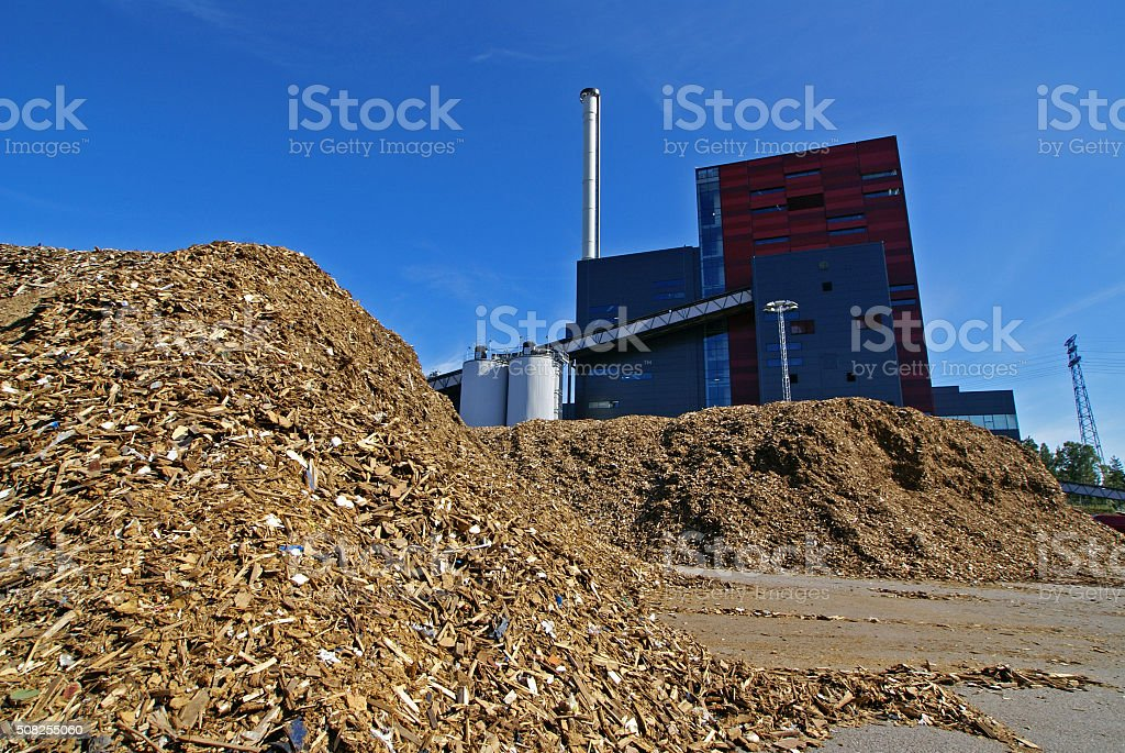 bio power plant with storage of wooden fuel (biomass) stock photo
