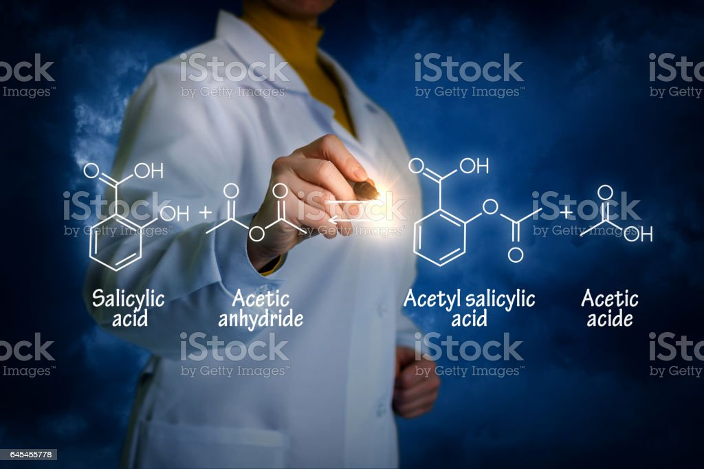 Biochemist writes the formula. stock photo