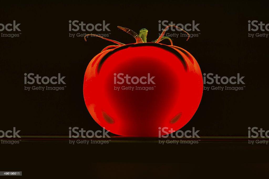 Biodesign, tomato, plastic, luminous, red, isolated, sparse, black, copy space stock photo