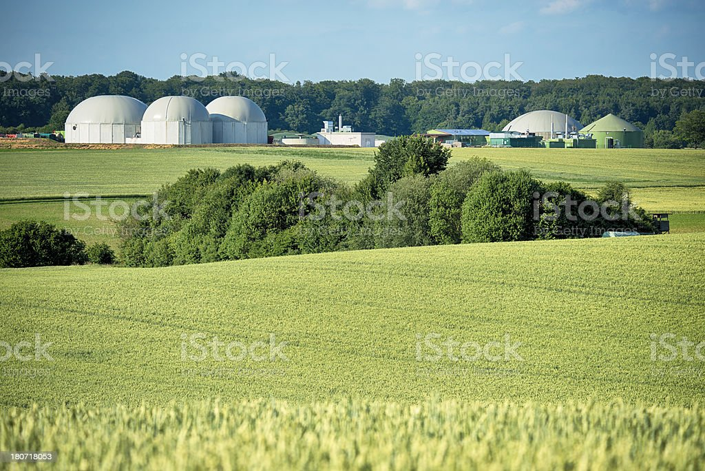 Bioenergie, Biomass energy plant in a rural landscape royalty-free stock photo